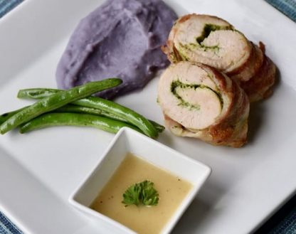 Bacon Wrapped Turkey Medallions filled with Goat Cheese & Spinach.